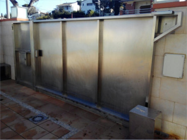 Puertas garaje automaticas barcelona instalar reparar for Puertas correderas barcelona